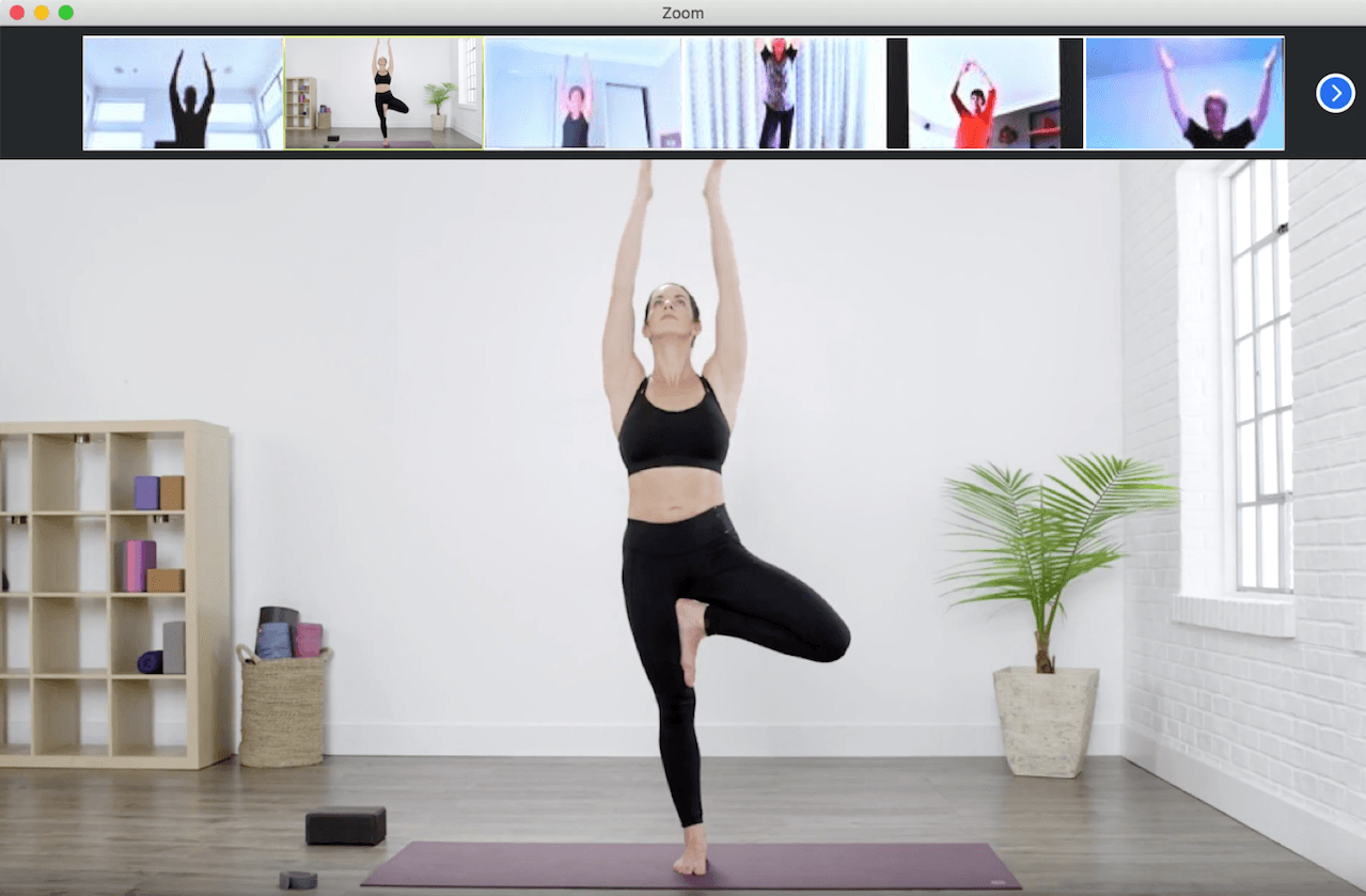 A zoom meeting where a yoga instructor is giving a class to blurred participants